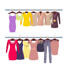 Racks with female tops and dresses on hangers vector