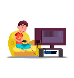 little boy playing video games on the couch vector image