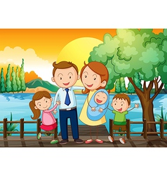 A happy family at the wooden bridge vector image