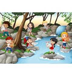 Children having fun at the waterfall vector image