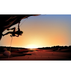 A sunset view of the desert with a man climbing at vector image vector image