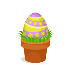 painted easter egg in ceramic pot with green grass vector image