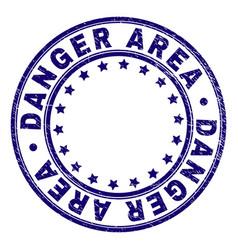 Grunge textured danger area round stamp seal vector