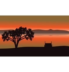 Single tree silhouette in lake vector image