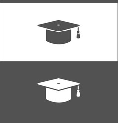 Mortarboard icon on black and white background vector