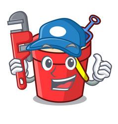 Plumber sand bucket mascot cartoon vector
