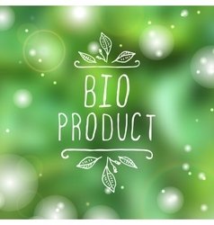 Bio product - label on blurred background vector image