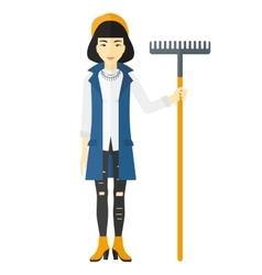 Woman standing with rake vector