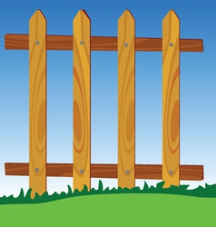 Wooden fence in park with blue sky in background vector
