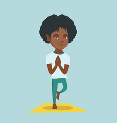 Young african woman practicing yoga tree pose vector
