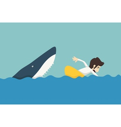 Businessman swimming to escape sharks vector image