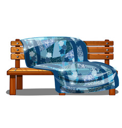 Wooden bench covered with a warm blanket or a vector