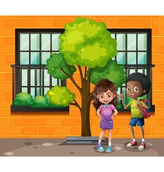 Boy and girl standing on the street vector