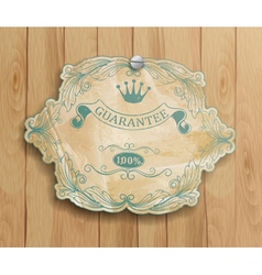 vintage label on the wooden background vector image vector image