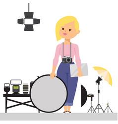 Woman photographer with studio equipment vector