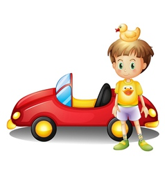 A young boy with a rubber duck and a big toy car vector image vector image