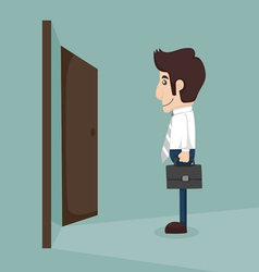 Businessman walking to opened door vector image