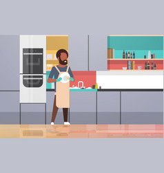 Young man washing dishes african american guy vector