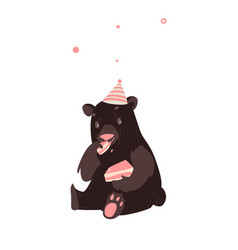 bear in party hat sitting and eating birthday cake vector image