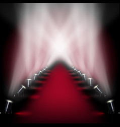 Red carpet runway with spotlights vector