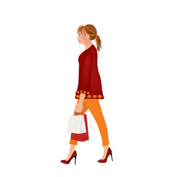 modern woman carrying a shopping bags vector image vector image