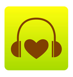 Headphones with heart brown icon at green vector