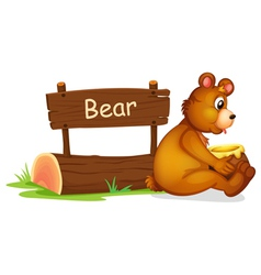 A bear sitting beside a wooden signage vector image