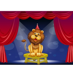 A lion sitting above a round table vector image vector image