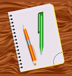Notebook orange pen and green pen vector