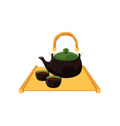 Chinese japanese tea pot and cups on wooden trivet vector