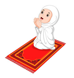 Muslim girl sitting on the prayer rug while prayin vector