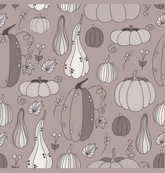 Seamless pattern with hand drawn doodle pumpkins vector