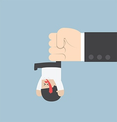 Businessman hanging from upside down by a big hand vector