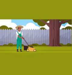 Man gardener cutting green grass with lawn mover vector