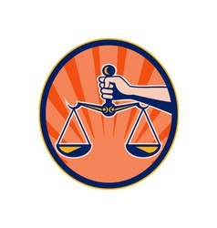 Hand holding scales of justice vector image