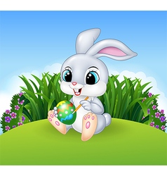 Cartoon Easter Bunny painting an egg in the jungle vector image vector image