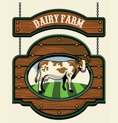 Dairy farm sign with cow image vector