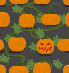 Scary halloween pumpkin among plantation of vector image