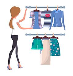 Woman choosing new summer vogue shirts and shorts vector