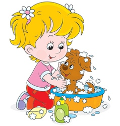 Girl washing a puppy vector image