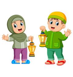 moslem kids holding lantern vector image