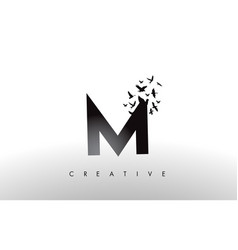 M logo letter with flock of birds flying and vector