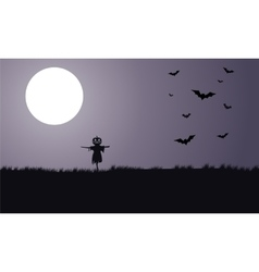 Silhouette of scarecrow and bat Halloween vector image