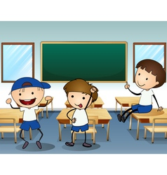 Three boys laughing inside the classroom vector image