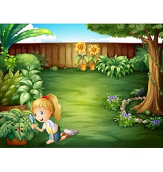 A girl studying the plants in the garden vector image vector image