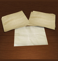 background old paper pile on a wooden board vector image