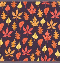 autumn leaves pattern on dark background vector image