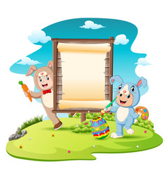 happy kids wearing bunny costume and painting egg vector image