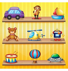 Different toys arranged at the wooden shelves vector