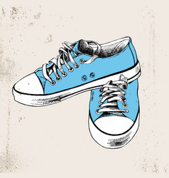 Pair of hand drawn blue sneakers vector
